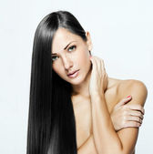 Beautiful woman with long dark shiny hair — Stock Photo