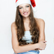 Beautiful smiling woman in Santa hat — Stock Photo