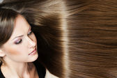 Portrait of a beautiful woman with long hair — Stockfoto