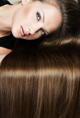 Portrait of a beautiful woman with long hair — Stock Photo