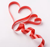 Red ribbon forming valentine's hearts — Photo