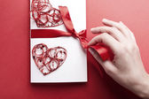 Valentines heart with envelope and hand — Stock Photo