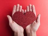 Valentine's paper heart in hands — Stock Photo