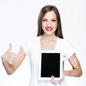 Beautiful woman holding tablet pc — Stock Photo