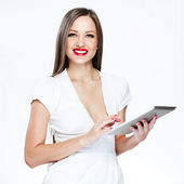 Smiling pretty woman holding tablet pc — Stock Photo