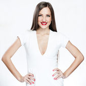 Close up of smiling young woman with arms akimbo on white background — Stock Photo