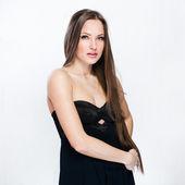A beautiful woman in a black dress — Stock Photo