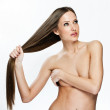 Woman with long beautiful hair covers her body with hand — Stock Photo