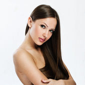Portrait of beautiful woman with long hair covering her naked body — Stock Photo