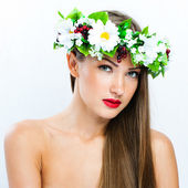 Fashion model with hairstyle and flowers in her hair — Stock Photo