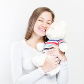 Brunette embraces teddy bear — Stock Photo