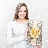 Woman with christmas gift — Stock Photo
