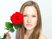 Portrait of a beautiful woman with flowers. — Stock Photo