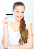 Business woman holding credit card — Stock Photo