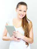 Young woman holding tablet computer — Stock Photo