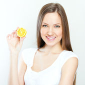 Portrait of young happy smiling woman with lemon — Stock Photo