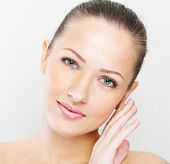 Beautiful face of young adult woman with clean fresh skin — Stock Photo