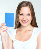 Woman holding passport — Stock fotografie