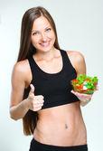 Woman eating vegetables salad — Stock Photo