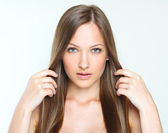 Girl with brown long shiny hair — Stock Photo