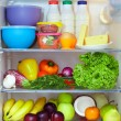 Stock Photo: Refrigerator full of healthy food. fruits, vegetables and dairy products