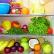 Refrigerator full of healthy food. fruits and vegetables — Stock Photo