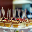 Many servings of sweet tasty dessert on buffet — Stock Photo #13549130
