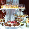 Many servings of sweet tasty dessert on buffet — Stock Photo #13549158