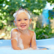 Royalty-Free Stock Photo: Cute smiling baby boy in bubble bath outdoor