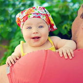 Cute little baby girl on her father — Stock Photo
