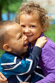 Poor and dirty but still happy and smlling little gypsy brother and sister — Stock Photo