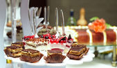 Many servings of sweet tasty dessert on buffet — Stock Photo