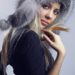 Seductive young blonde woman wearing fur hat — Stock Photo
