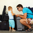 Father and son travel with huge luggage - Stock Photo