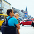 Father with son walking through crowded city street — Stock Photo