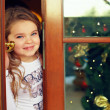 Beautiful baby girl looking out from door. christmas portrait — Stock Photo