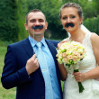 Stock Photo: Wedding couple with funny false mustache