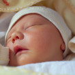 Stock Photo: Closeup portrait of adorable sleeping newborn baby