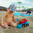 Cute baby boy playing with toys on beach — Stock Photo #13551712