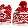 Winter cap and mittens knitted with jackard and heart motifs. on white — Stock Photo