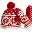 Winter cap and mittens knitted with jackard and heart motifs. on white — Stock Photo #13552327