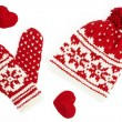 Winter cap and mittens knitted with jackard and heart motifs. on white — Stock Photo #13552400