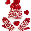 Winter cap and mittens knitted with jackard and heart motifs. on white — Stock Photo #13552458