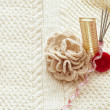 Set for home knitting with crochet  flower on pattern background - Stock Photo