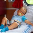 Little baby boy passenger traveling by train in sleeper car — Stok fotoğraf