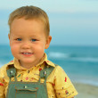 Close-up portrait of adorable smiling baby boy standing near the — Stock Photo
