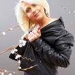 Young pretty blonde girl in leather jacket on floral background — ストック写真