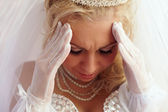 Close-up portrait of beautiful bride frown on the troubles and pain. white — Stock Photo