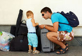 Father and son travel with huge luggage — Stock Photo