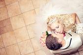 Beautiful blond bride and groom kissing. top view — Stock Photo